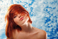 Summer teen girl beautiful freckles redheaded. Over blue sky stock image