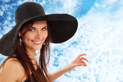 Summer teen girl cheerful in panama showing sky Stock Photo