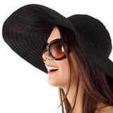 Summer teen girl cheerful in panama and sunglasses Stock Photography