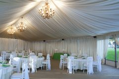 The summer tent is decorated on the wedding day. In green  tones Royalty Free Stock Photo