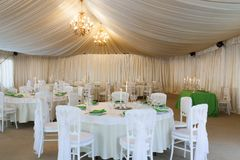 The summer tent is decorated on the wedding day. In green  tones Stock Image