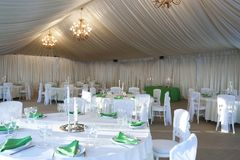 The summer tent is decorated on the wedding day. In green  tones Royalty Free Stock Photography