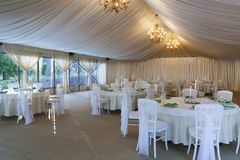 The summer tent is decorated on the wedding day. In pastel  tones Stock Images