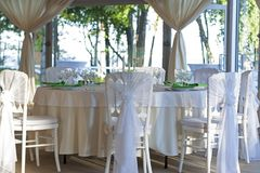 The summer tent is decorated on the wedding day. In green  tones Royalty Free Stock Photos
