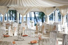 The summer tent is decorated on the wedding day. In pastel  tones Royalty Free Stock Photo