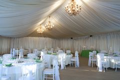 The summer tent is decorated on the wedding day. In pastel  tones Stock Image