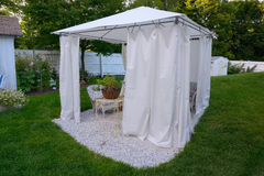 A summer tent enclosure in a New England Coastal Cottage and yar photo stock