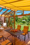 Summer terrace and garden. View from a cozy winter garden in the large natural garden in summer Stock Photography