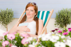 Summer terrace red hair woman relax in deckchair Royalty Free Stock Image