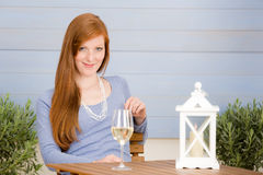 Summer terrace redhead woman with glass of wine Stock Image