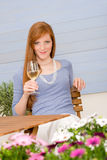 Summer terrace redhead woman hold glass of wine Royalty Free Stock Images