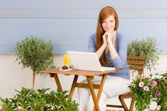 Summer terrace redhead woman with laptop Stock Photos