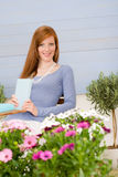 Summer terrace redhead woman relax in garden Stock Photography