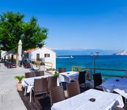A summer terrace seaside view of traditional european mediterran. Ean restaurant Stock Photography