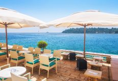 A summer terrace seaside view of traditional european mediterran. Ean restaurant Stock Images