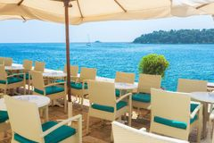 A summer terrace seaside view of traditional european mediterran. Ean restaurant Royalty Free Stock Photography