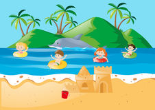 Summer theme with kids swimming in ocean Stock Photo