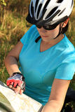 Summer theme. Woman on bicycle reading a map. Royalty Free Stock Images