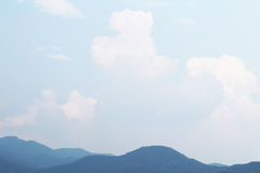 Summer thunderhead and the sky and mountains Stock Photos