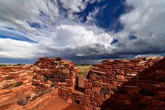 A summer thunderstorm drifts across Wupatki National Monument in northern Arizona. stock photo