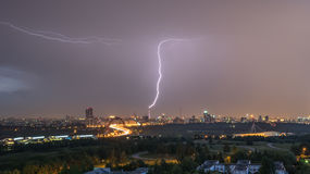 Summer thunderstorm with lightning. Over city at night Stock Images