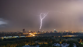 Summer thunderstorm with lightning. Over city at night Stock Photo