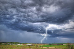 Summer thunderstorm over the meadow Royalty Free Stock Photo