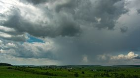 Summer thunderstorm over the village and the field. Time lapse stock footage