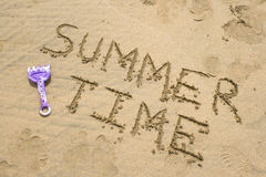 Summer time. Written in the sand Stock Photos