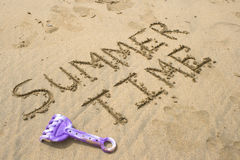 Summer time. Written in the sand Stock Images