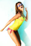 Summer time. Young happy woman in bikini and wet T-shirt Royalty Free Stock Image