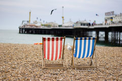 Summer Time. Brighton Beach deck chairs and pier Royalty Free Stock Images