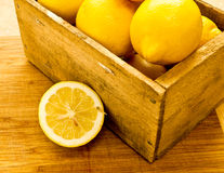 Summer Time. Summer - time for something cold and refreshing. A juicy fresh cut lemon, perhaps destine to become lemonade royalty free stock photo