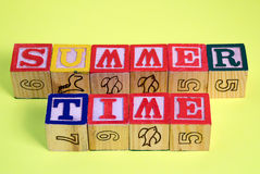 Summer Time. The words summer time spelled out using infants building blocks Royalty Free Stock Photo