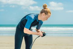Summer time and active rest concept. Young surfer woman beginner stock image
