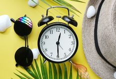 Summer Time Alarm Clock Between Flat Lay Summer Beach Accessories.  stock photo
