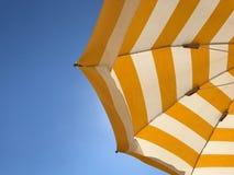 Summer time on the beach. Beach umbrella under the blue sky Stock Photos