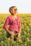 Summer time - Beautiful Day. A beautiful young woman and yellow flowers Stock Photography