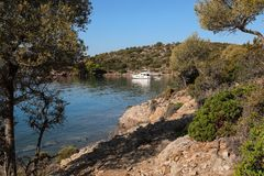 Summer time a beautiful yacht anchoring in Love bay Poros island Greece. Horizontal Royalty Free Stock Photos