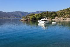 Summer time a beautiful yacht anchoring in Love bay Poros island Greece. Horizontal Royalty Free Stock Photography