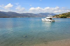 Summer time a beautiful yacht anchoring in Love bay Poros island Greece. Horizontal Royalty Free Stock Photo