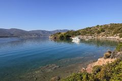 Summer time a beautiful yacht anchoring in Love bay Poros island Greece. Horizontal Royalty Free Stock Images