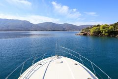 Summer time a beautiful yacht anchoring in Love bay Poros island Greece. Horizontal Stock Photography