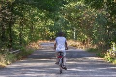 It is summer, time for bicycle tours in nature. NIt is summer, time for bicycle tours, we`re back on the road to explore the world Royalty Free Stock Photo