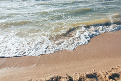 Summer time blue sea waves yellow sun and sand Royalty Free Stock Photo