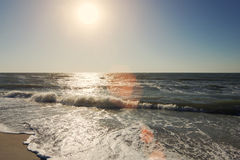 Summer time blue sea waves yellow sun and sand Royalty Free Stock Photos