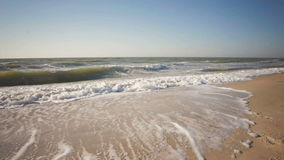 Summer time blue sea waves yellow sun and sand stock video