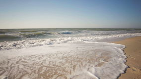 Summer time blue sea waves yellow sun and sand stock video footage