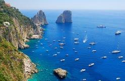 Summer time in Capri island. Famous Faraglioni rocks of Capri island, Italy royalty free stock images