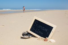 Summer time chalkboard on beach background Stock Image